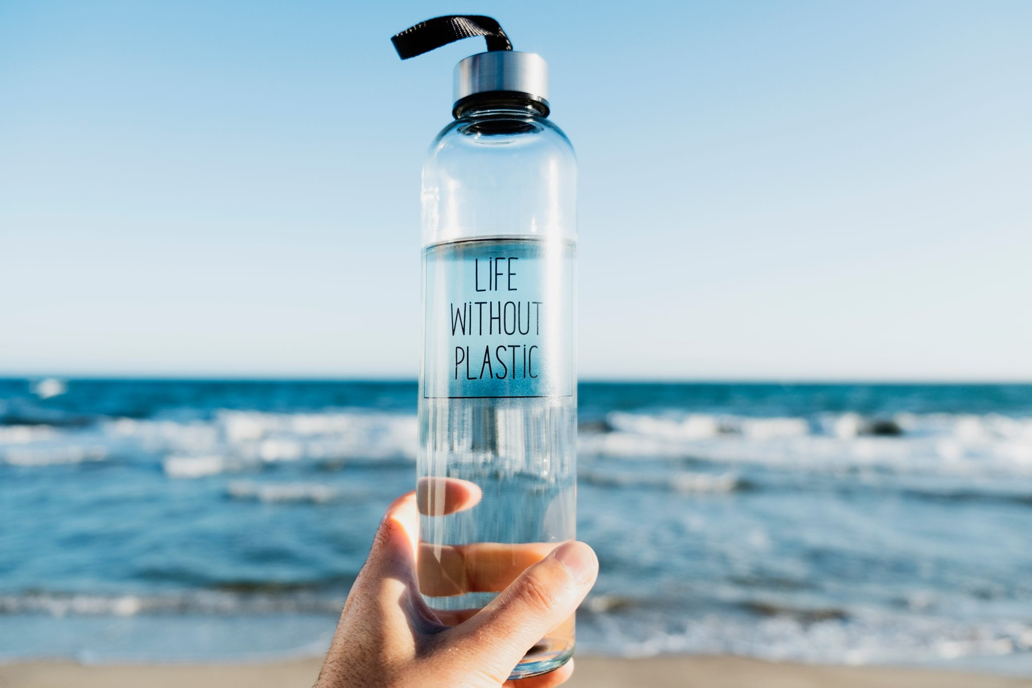 Reusable water bottle on beach