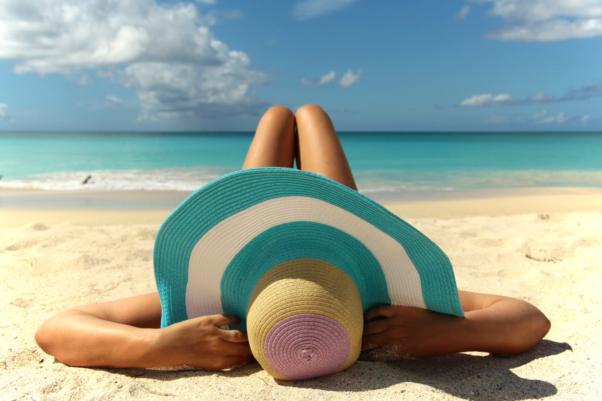 Woman wearing wide-brimmed hat on beach