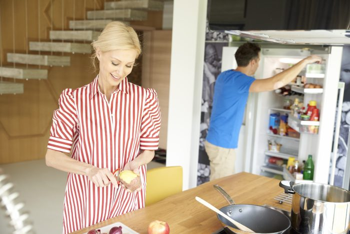 Blonde Woman Cooking For Brain Health With Husband